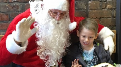 Father Christmas calls in for breakfast surprise at Marshall's Yard